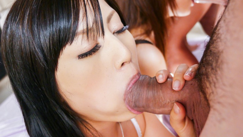 two japanese milfs on knees sucking dicks